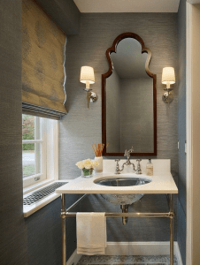 powder room-bathroom-gray-wallpaper-sconces-mirror