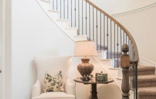 stairs-curved-mill work-architectural - molding- white-carpet-entryway-wood-chandelier-white