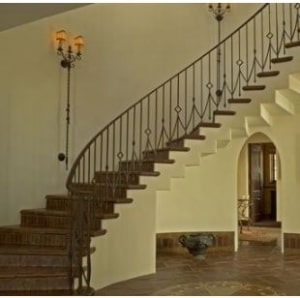 stairs-curved-wood-sconces-large-light-iron-black