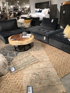family room, sectional, gray, earth tones. classic home, las vegas market, trends, tufted, wood, round, coffee table, rugs, sisal, pillows