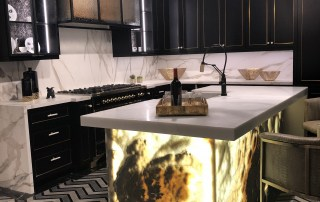 kitchen-onyx-island-gold-black-cabinets-lighting-chandelier-tile-trends-las vegas