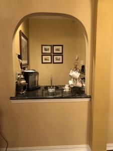 terravista, interior design, bar, remodel, renovation, wainscot , white, molding, mill work, wine, arch, doorway, home, wine storage